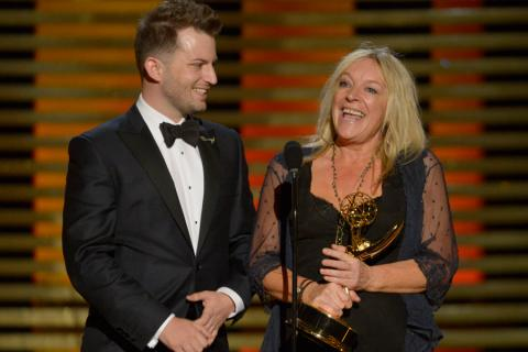 Adam James Phillips and Magi Vaughn accept the award for outstanding hairstyling on Downton Abbey.