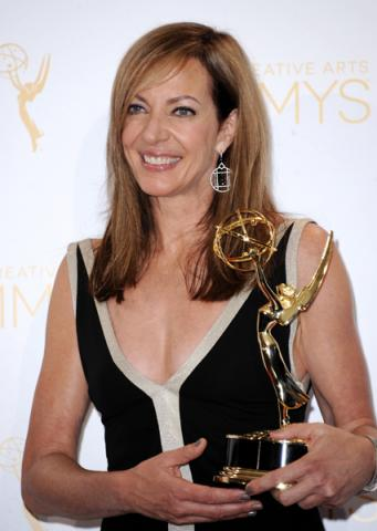 Masters of Sex guest actress Allison Janney celebrates her win at the 2014 Primetime Creative Arts Emmys.