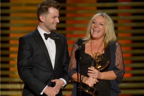 Adam James Phillips and Magi Vaughn accept the award for outstanding hairstyling for a single-camera series for their work on Downton Abbey.