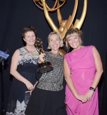 Game of Thrones costume designers Nina Ayres (l), Michele Clapton (c), and Sheena Wichary (r) celebrate their win at the 2014 Primetime Creative Arts Emmys.