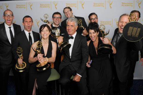 Anthony Bourdain and crew of Anthony Bourdain: Parts Unknown celebrate their win at the 2014 Primetime Creative Arts Emmys.