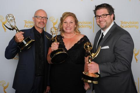 Dancing With the Stars lighting team members Simon Miles (l), Suzanne Sotelo (c) and Matthew Cotter (r) celebrate their win at the 2014 Primetime Creative Arts Emmys.