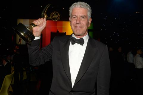 Anthony Bourdain of Anthony Bourdain: Parts Unknown celebrates at the 2014 Creative Arts Emmys ball.