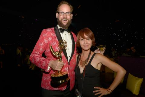 Opus Moreschi (l) of The Colbert Report and Linda Abbott (r) celebrate at the 2014 Creative Arts Emmys ball.