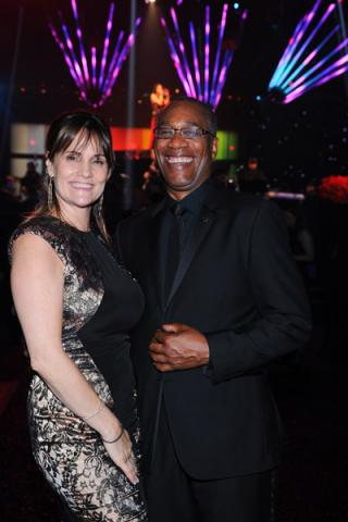 Christine Lietz (l) and Scandal winner Joe Morton (r) celebrate at the 2014 Creative Arts Emmys ball.