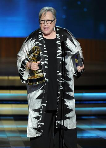 Kathy Bates of American Horror Story: Coven accepts an award at the 66th Emmys.