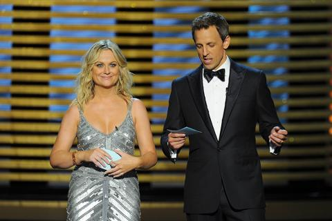 Amy Poehler (l) of Parks and Recreation and Seth Meyers of Late Night With Seth Meyers at the 66th Emmy Awards.