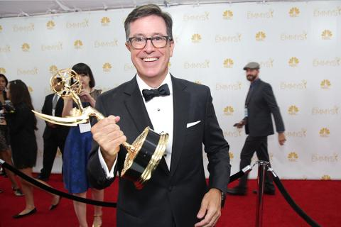 Stephen Colbert of The Colbert Report celebrates at the 66th Emmys.