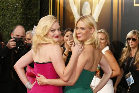 Elisabeth Moss and January Jones on the red carpet at the 67th Emmy Awards.