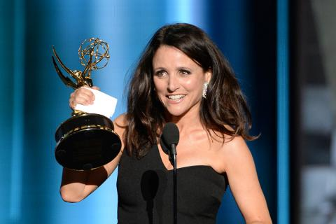 Julia Louis-Dreyfus accepts an award at the 67th Emmy Awards.