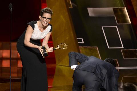 Jon Hamm accepts an award at the 67th Emmy Awards.