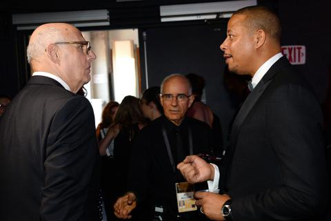 Jeffrey Tambour and Terrence Howard backstage at the 67th Emmy Awards.