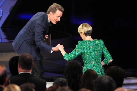 Bryan Cranston presents the award to Sarah Paulson at the 2016 Primetime Emmys.