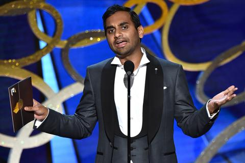 Aziz Ansari presents an award at the 2016 Primetime Emmys.