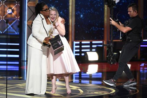 Elisabeth Moss accepts an award at the 2017 Primetime Emmys.