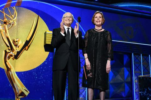 Norman Lear and Carol Burnett on stage at the 69th Emmy Awards.
