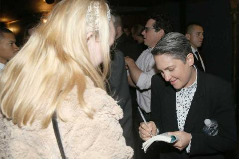 Jill Soloway signs an autograph at the reception following Transparent: Anatomy of an Episode, March 17, 2016 in Los Angeles.