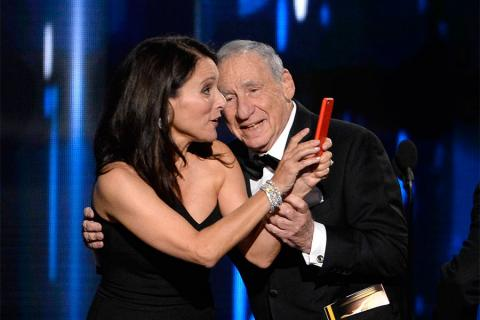 Julia Louis-Dreyfus and Mel Brooks onstage at the 67th Emmy Awards.