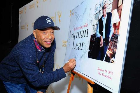 Russell Simmons signs in at An Evening with Norman Lear at the Moltalban Theater in Hollywood.