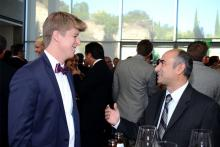 Tim Kolenot and Henry Safarian chat at the 67th Los Angeles Area Emmy Awards cocktail party July 25, 2015, at the Skirball Cultural Center in Los Angeles, Californis.