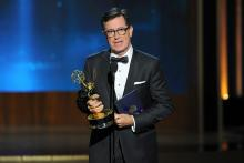 Stephen Colbert accepts the award for outstanding supporting actor in a miniseries or a movie on behalf of Martin Freeman for his work on Sherlock: His Last Vow (Masterpiece) at the 66th Primetime Emmys.
