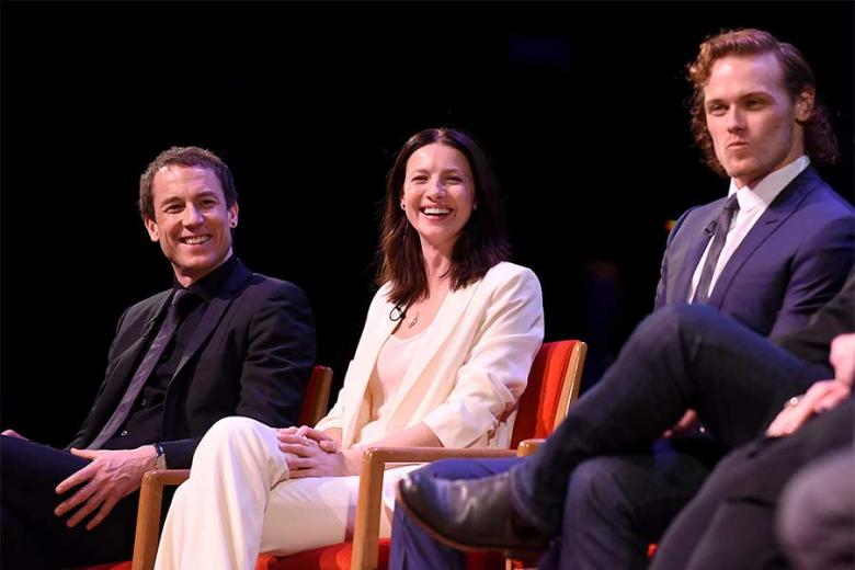 Actors Tobias Menzies Catriona Balfe and Sam Heughan participate in the panel at the Outlander: From Scotland to Paris event April 5 2016 at the NYU Skirball Center for the Performing Arts in New York City.