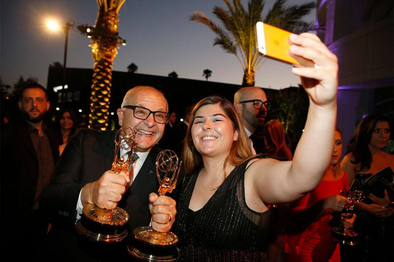 Ruben Keoseyan and Jacklyn Keoseyan capture the moment at the L.A. Area Emmy Awards presented at the Television Academy's Wolf Theatre at the Saban Media Center on Saturday July 22 2017 in North Hollywood California.