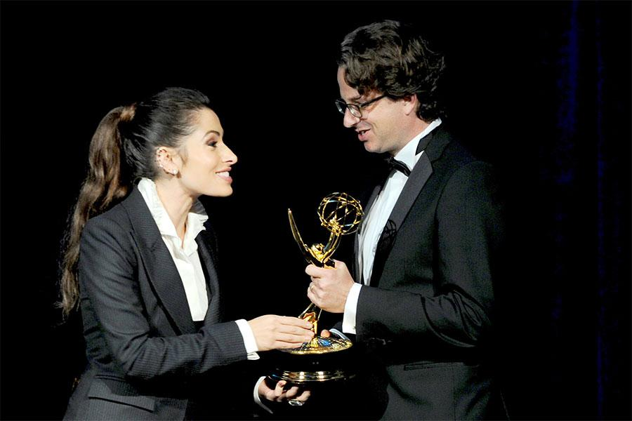 Host Sarah Shahi presents an Emmy to Daniel Sennheiser