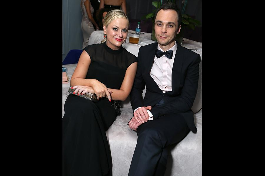 Amy Poehler and Jim Parsons relax in the Audi Green Room at the 65th Emmy Awards.