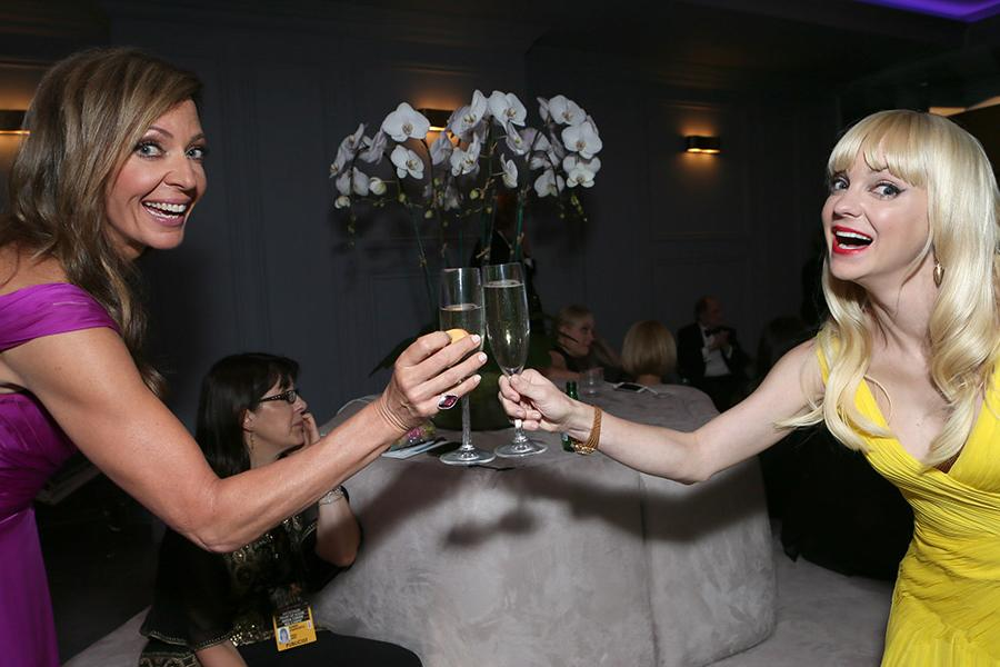 Allison Janney and Anna Faris share a toast in the Audi Green Room at the 65th Emmy Awards.
