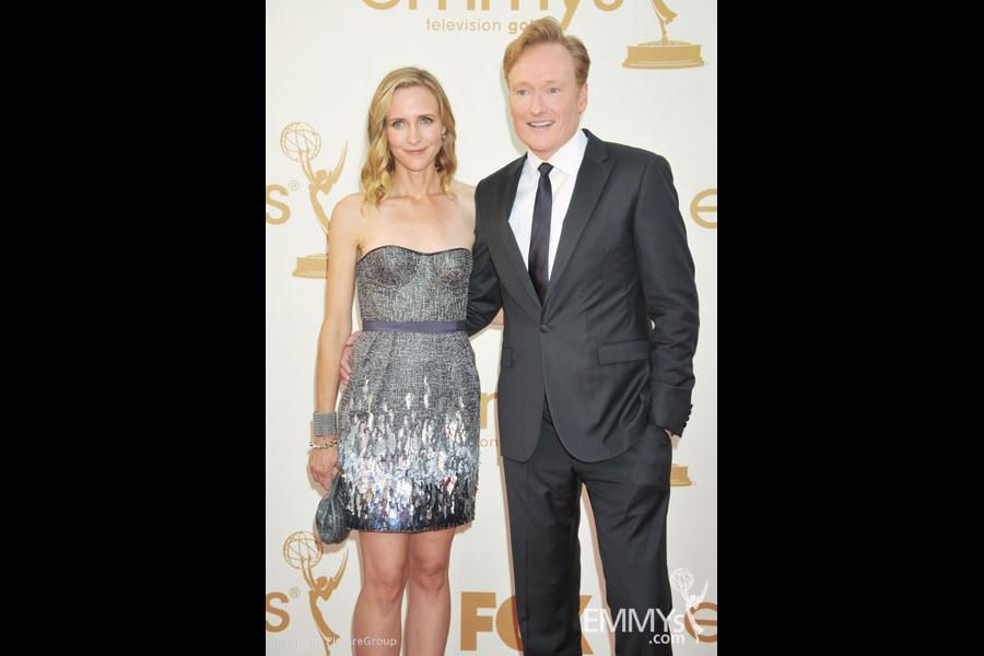 (L-R) Liza Powel, Conan O'Brien arrive at the Academy of Television Arts & Sciences 63rd Primetime Emmy Awards at Nokia Theatre