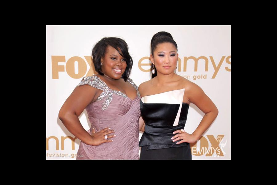 (L-R) Amber Riley and Jenna Ushkowitz arrives at the Academy of Television Arts & Sciences 63rd Primetime Emmy Awards
