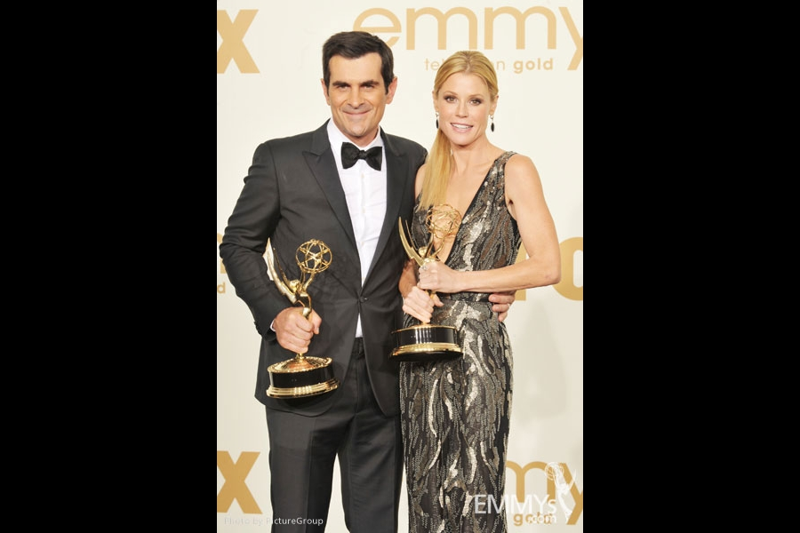 "(L-R) Ty Burrell poses with the award for ""Oustanding Supporting Actor in A Comedy Series"" and Julie Bowen poses with the award"