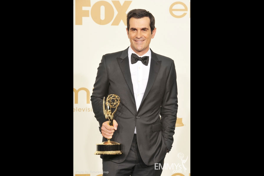 """Ty Burrell poses with the award for """"Oustanding Supporting Actor in a Comedy Series"""" in the press room"""