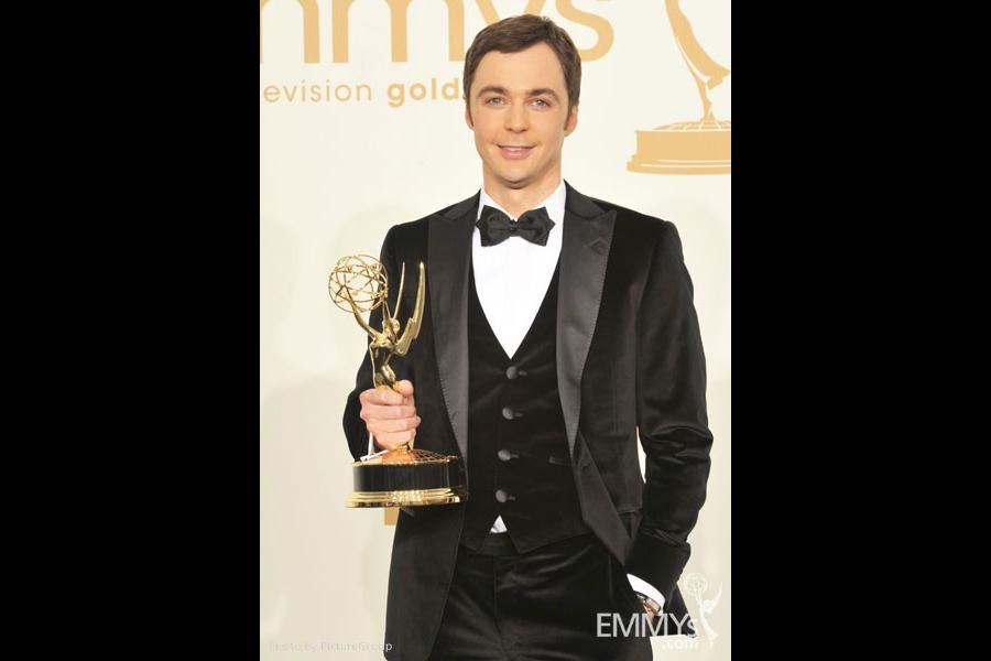 """Jim Parsons poses with the award for """"Outstanding Lead Actor in a Comedy Series"""" in the press room"""