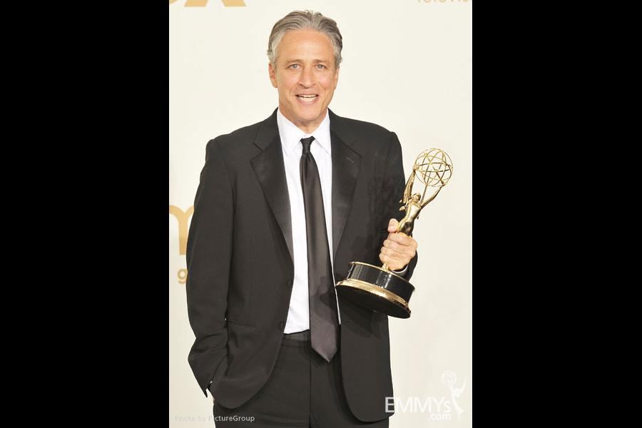"""Jon Stewart poses with the award for """"Outstanding Variety, Music or Comedy Series"""" in the press room"""