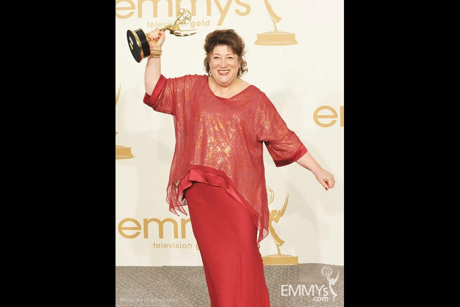 """Margo Martindale poses with the award for """"Outstanding Supporting Actress in a Drama Series"""" in the press room"""