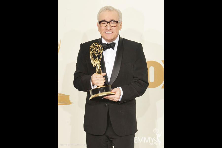 """Martin Scorsese poses with the award for """"Outstanding Directing for a Drama Series"""""""