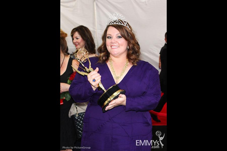 "Melissa McCarthy with the award for ""Outstanding Lead Actress in a Comedy Series"" at the trophy table"