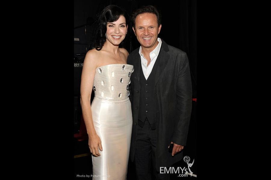 Julianna Margulies (L) and Mark Burnett backstage during the Academy of Television Arts & Sciences 63rd Primetime Emmy Awards