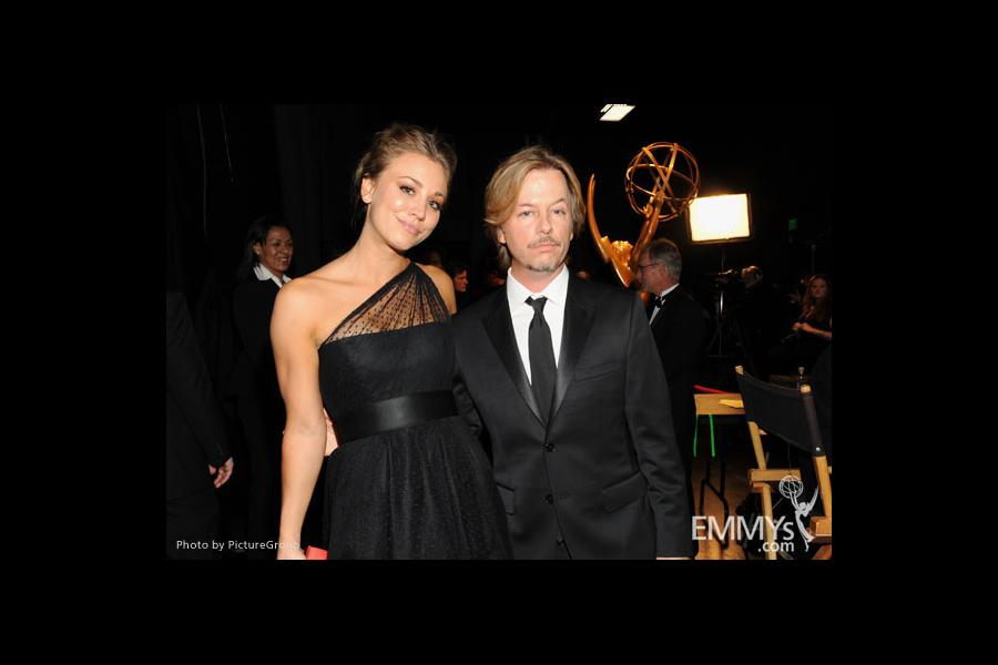 Kaley Cuoco (L) and David Spade (R) backstage during the Academy of Television Arts & Sciences 63rd Primetime Emmy Awards