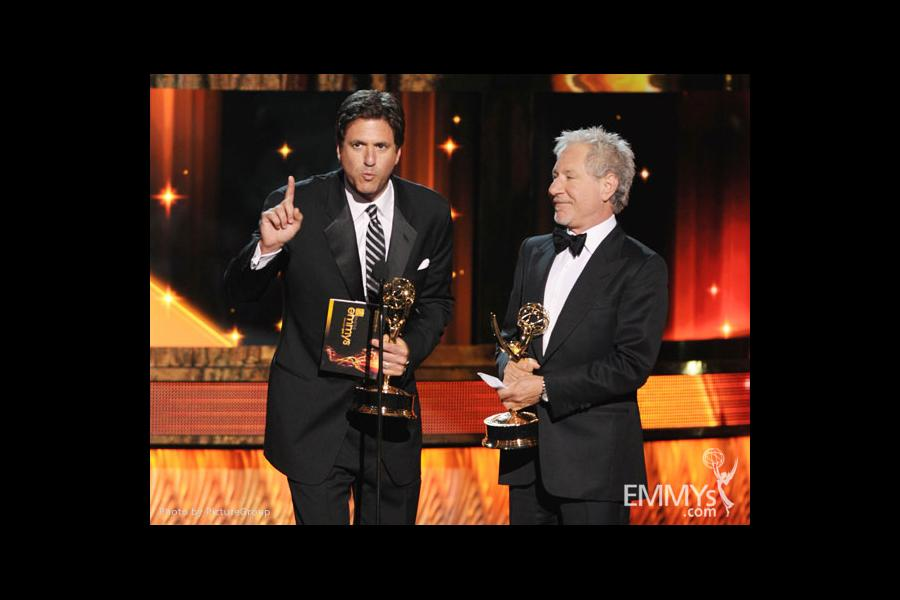 Steven Levitan and Jeffrey Richman accept the award for Outstanding Writing for a Comedy Series