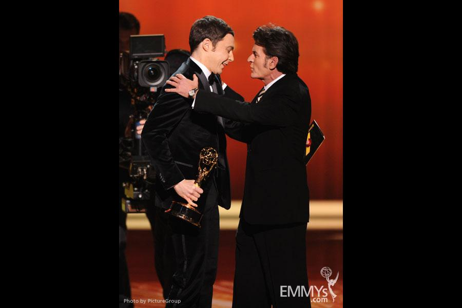 """(L-R) Jim Parsons accepts the award for """"Outstanding Lead Actor in a Comedy Series"""" from Charlie Sheen"""