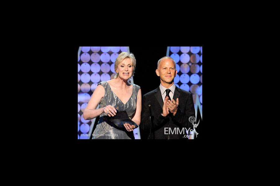 Actress Jane Lynch (L) and writer/creator Ryan Murphy speak onstage during the 62nd Primetime Creative Arts Emmy Awards at Nokia