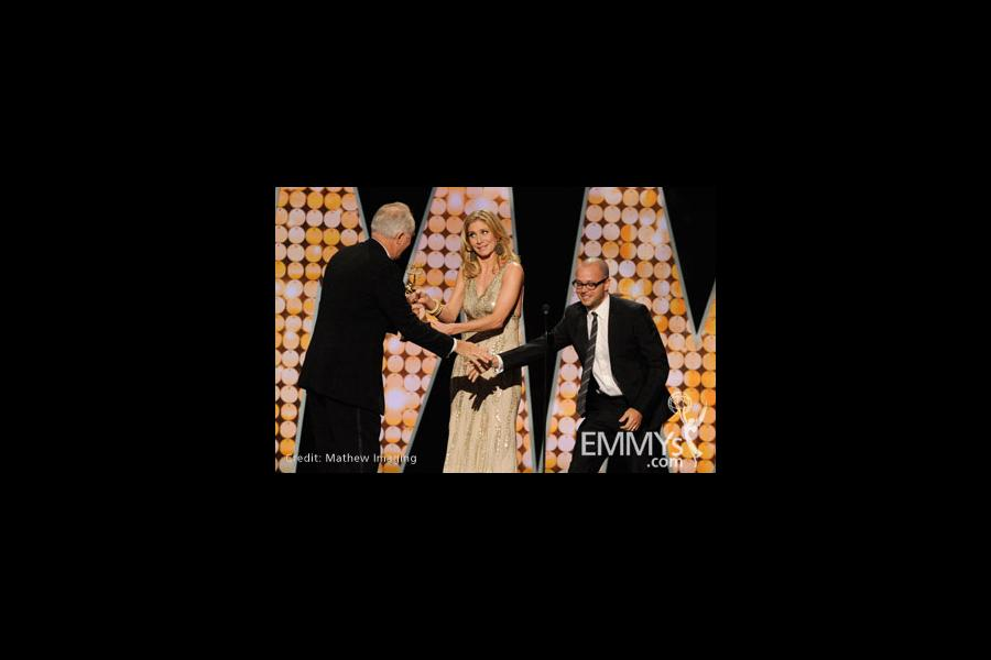 John Lithgow (L) accepts the Best Guest Actor in a Drama Series award from Elizabeth Mitchell