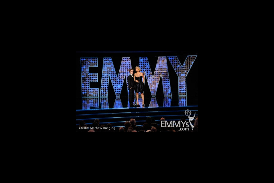 Actors Seth Green and Erika Christensen speak onstage during the 62nd Primetime Creative Arts Emmy