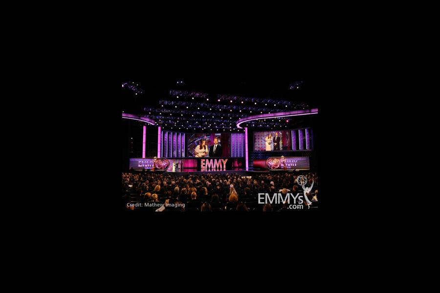Stana Katic (L) and Andrew W. Marlowe speak onstage during the 62nd Primetime Creative Arts Emmy Awards