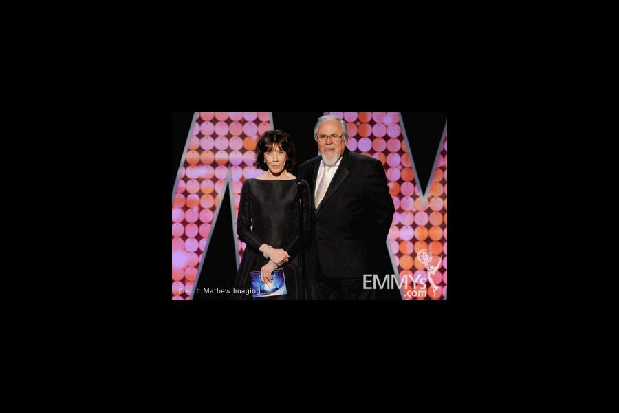 Lily Tomlin (L) and George Schlatter speak onstage during the 62nd Primetime Creative Arts Emmy Awards