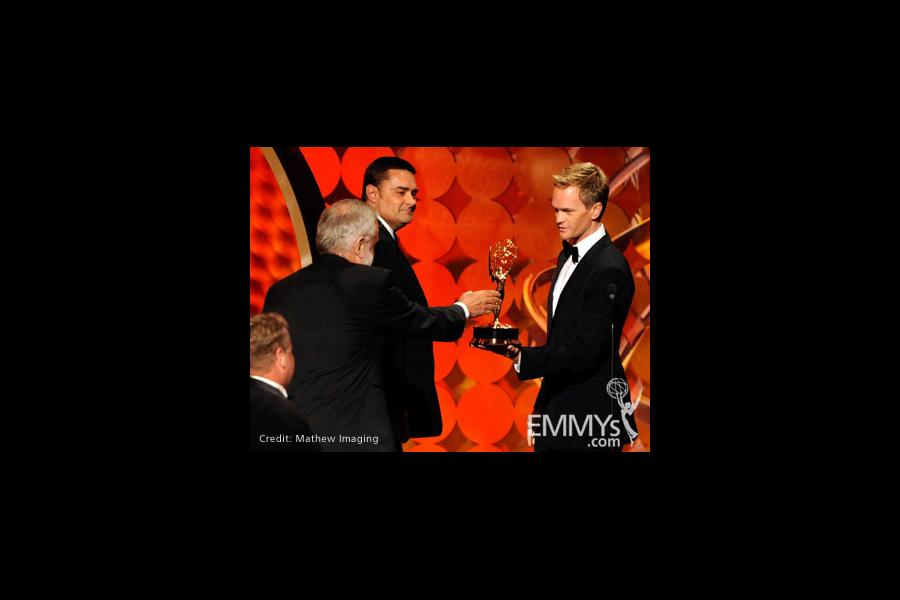 """Winners of Best Art Direction for Movie/Mini for """"The Pacific"""" with Neil Patrick Harris onstage"""