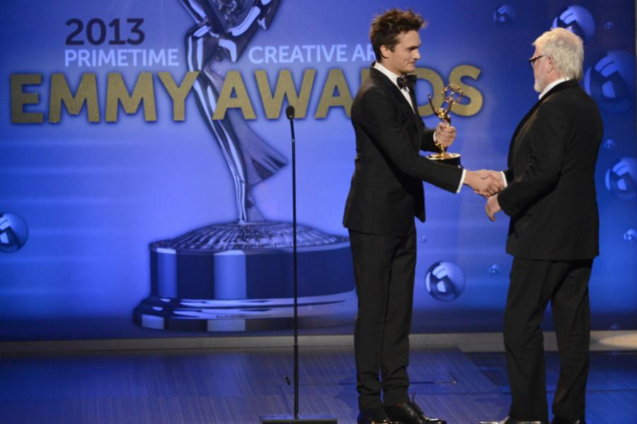 Rupert Friend presents Bill Groom with the award for Outstanding Art Direction For A Single-Camera Series for Boardwalk Empire